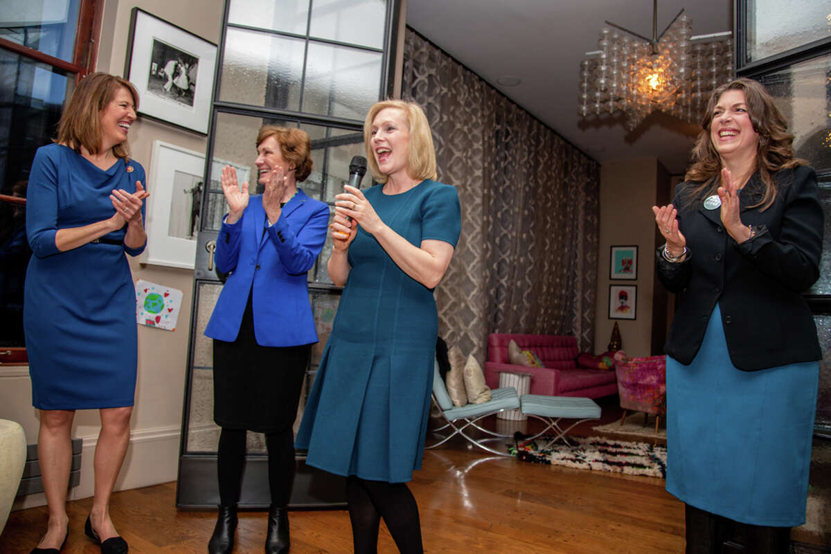 U.S. Sen. Kirsten Gillibrand, D-N.Y., (center) speaks at a fundraising event for her leadership PAC Off the Sidelines in Manhattan in December 2019 with (L to R) U.S. Rep. Cindy Axne, D-Iowa, Kansas Democrat Barbara Bollier and New York Democrat Tedra Cobb.