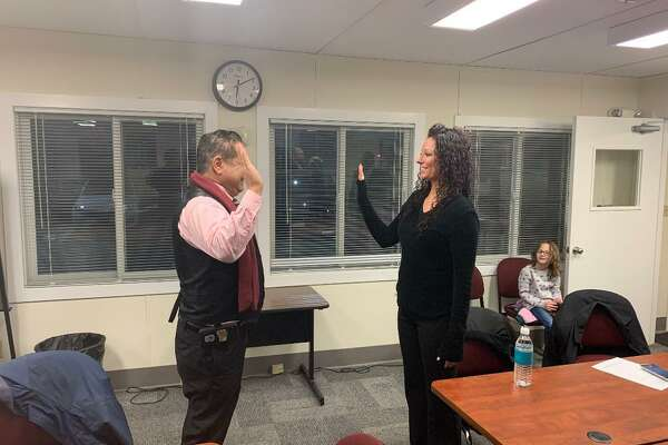 Ansonia Mayor David Cassetti administers the oath of office allowing Beth LaBerge to sit as a temporary member of the Board of Education until a state court judge decides who has the authority to fill vacancies.