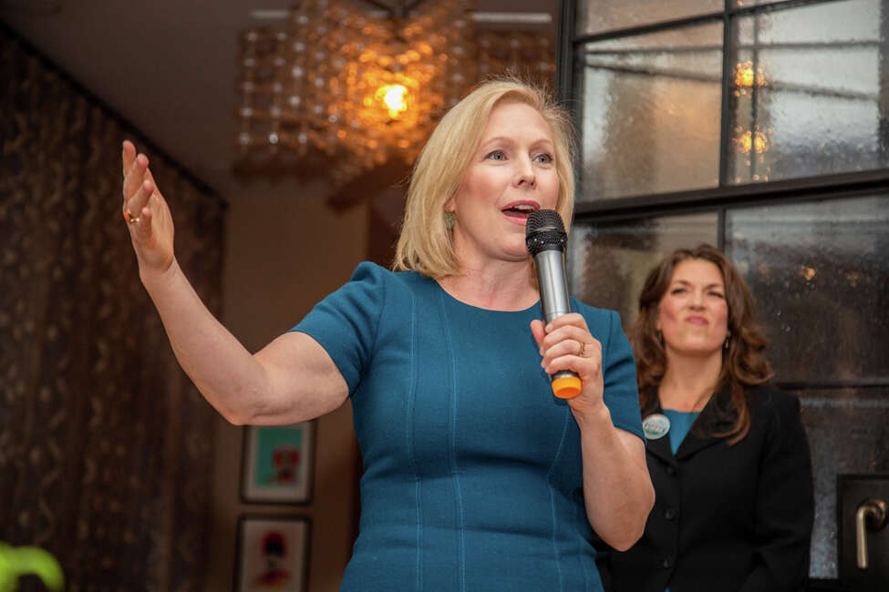 U.S. Sen. Kirsten Gillibrand, D-N.Y. speaks at a fundraiser for her leadership PAC Off the Sidelines in Manhattan in December 2019, while New York Democrat Tedra Cobb, a candidate in the 21st District, stands behind.