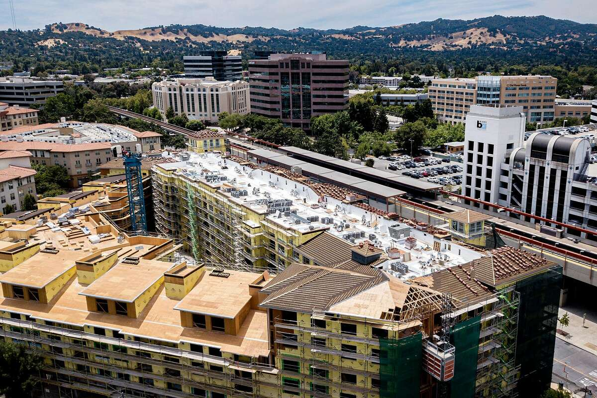 The Pleasant Hill/Contra Costa Centre BART station on June 2019 in Walnut Creek. Housing development is seen in the foreground.