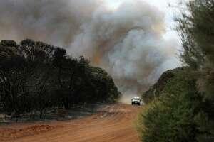 A plume of bushfire smoke rises above Mount Taylor Road bordering local farm land on January 11, 2020 in Karatta, Australia.