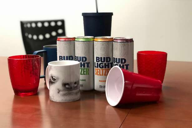 Bud Light Seltzer flavors include Lemon Lime, Black Cherry, Strawberry and Mango. Also pictured: Formal tasting goblets.