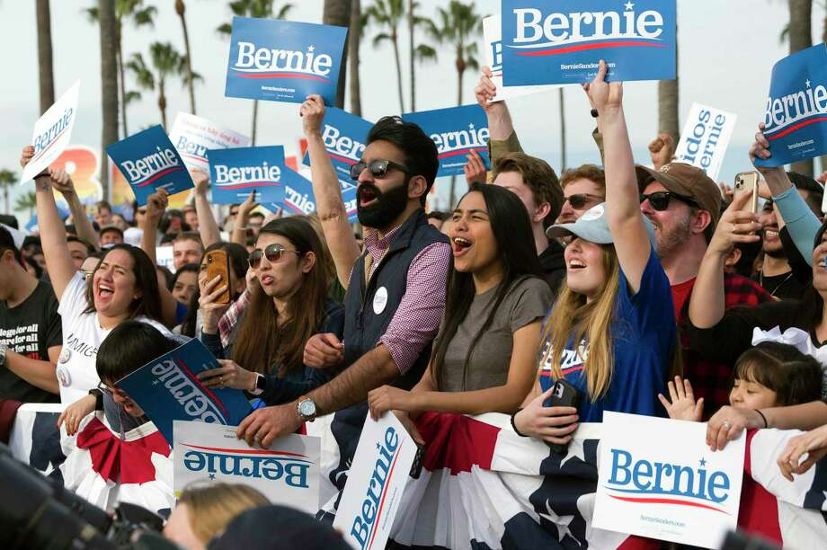 Supporters cheer during a rally for Democratic presidential candidate Sen. Bernie Sanders in Venice, Calif., last month. A reader is astounded any American would support his policies. Photo: Kelvin Kuo /Associated Press / Copyright 2019 The Associated Press. All rights reserved.