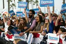 Supporters cheer during a rally for Democratic presidential candidate Sen. Bernie Sanders in Venice, Calif., last month. A reader is astounded any American would support his policies.