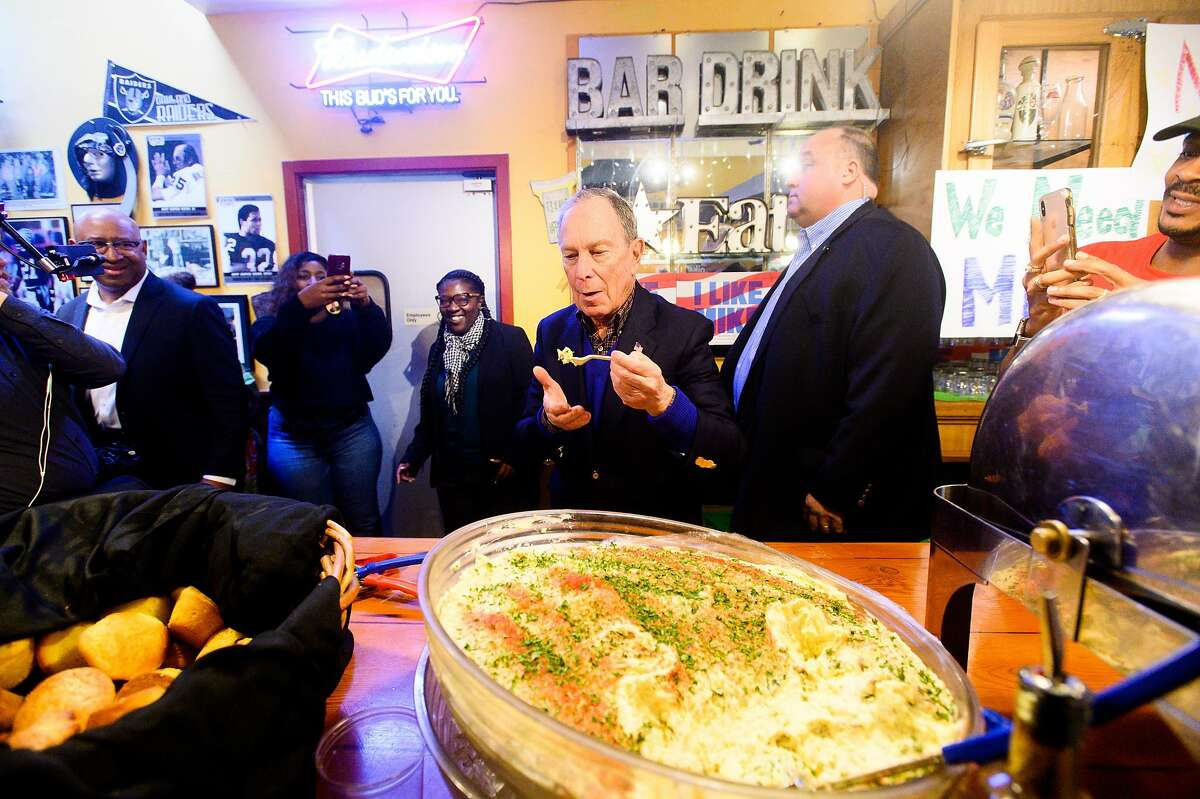 Democratic presidential candidate Michael Bloomberg samples potato salad during a campaign event at Everett & Jones Barbeque in Oakland, Calif., on Friday, Jan. 17, 2020.