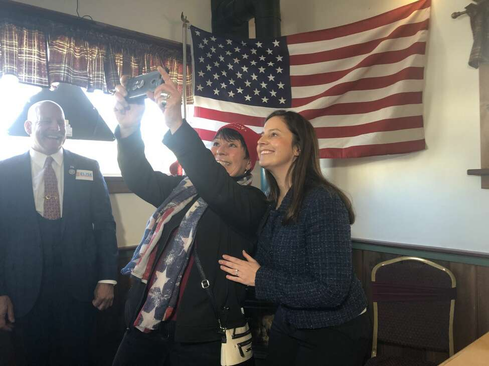 U.S. Rep. Elise Stefanik, R-Schuylerville, takes a selfie with a supporter in Johnstown, N.Y. on Jan. 17, 2020.