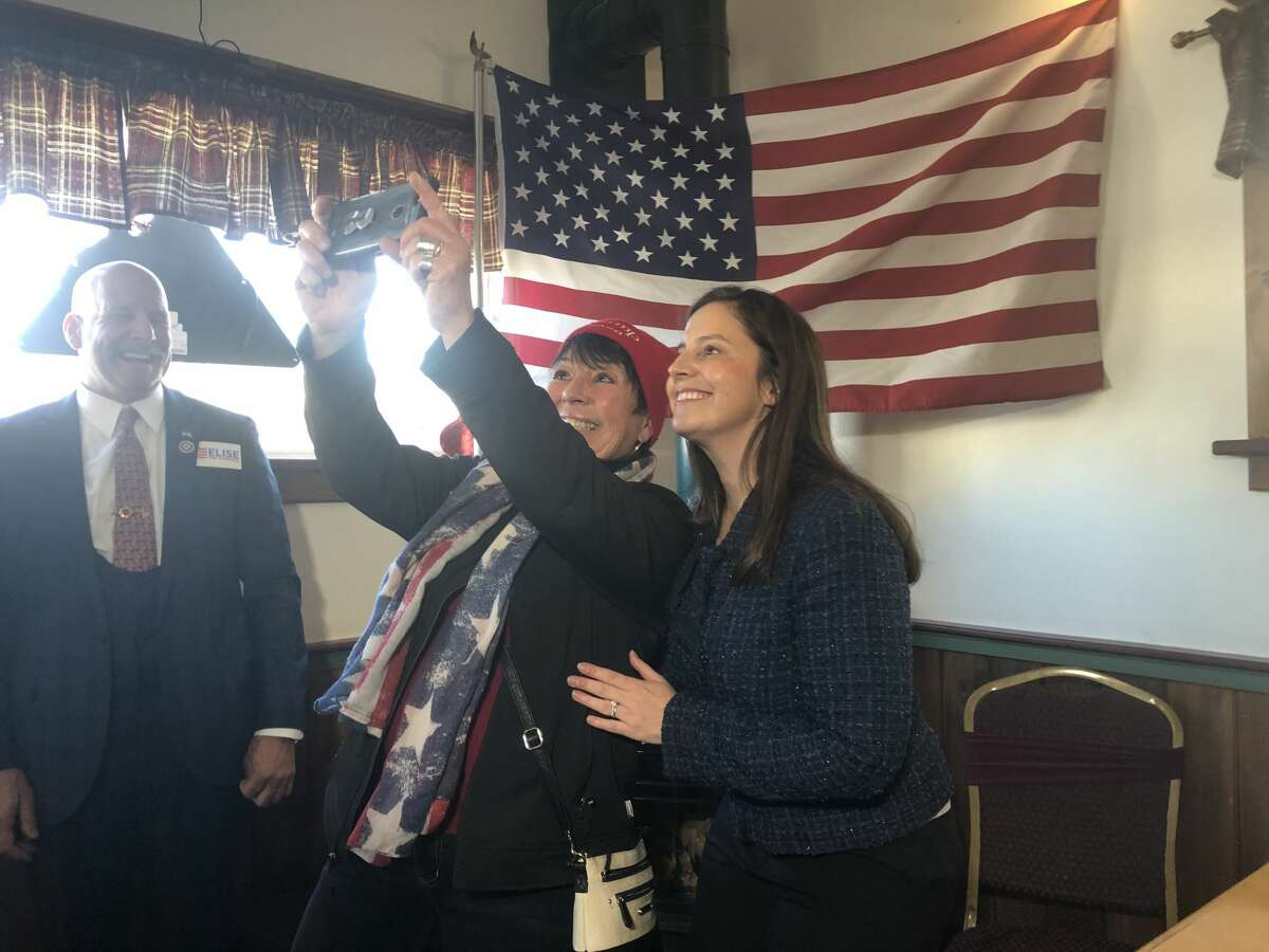U.S. Rep. Elise Stefanik, R-Schuylerville, takes a selfie with a supporter in Johnstown, N.Y. on Jan. 17, 2020.