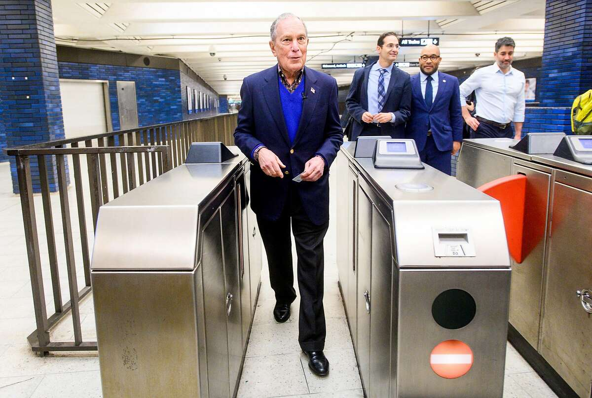 Democratic presidential candidate Michael Bloomberg arrives at the 19th Street BART station in Oakland, Calif., on Friday, Jan. 17, 2020.
