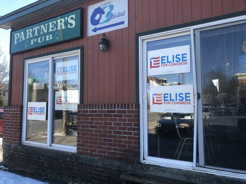 Elise for Congress signs are pictured in the window of Partner's Pub in Johnstown, N.Y. on Jan. 17, 2020.
