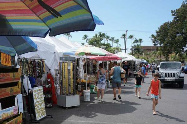 Shoppers making their way through local shops at a flea market on Nov 21, 2018 in Kona, Hawaii. Hawaii's Big Island ranks as the No. 1 trending destination in the 2020 Kayak Travel Hacker Guide.