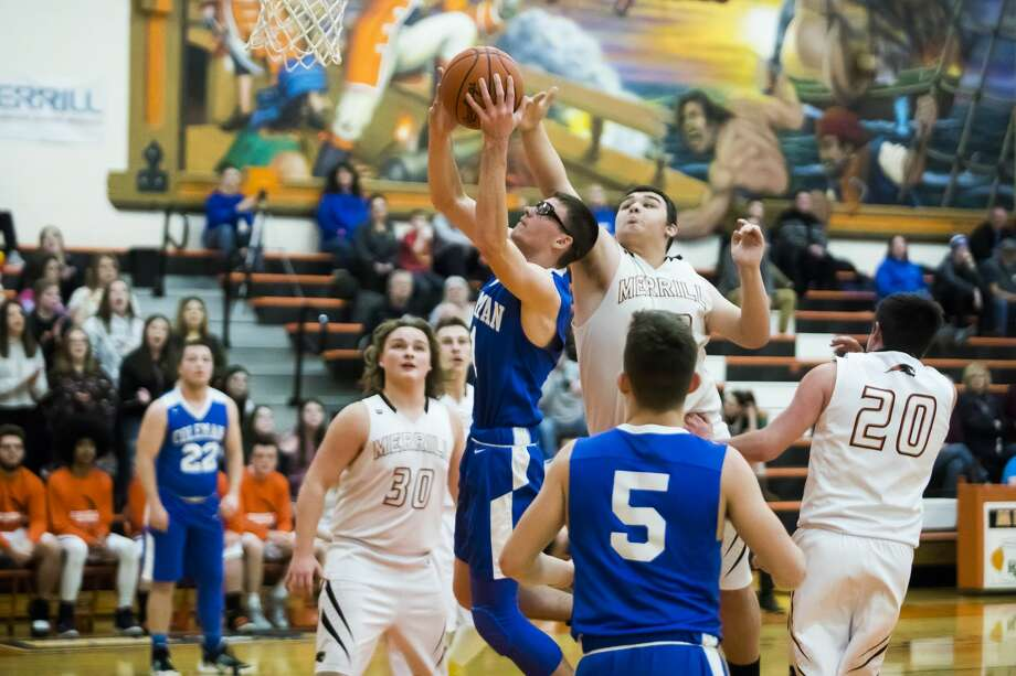 Coleman's Connor Arnold goes strong to the rim during a Jan. 16, 2020 game against Merrill. Photo: Katykildee/kildee@mdn.net