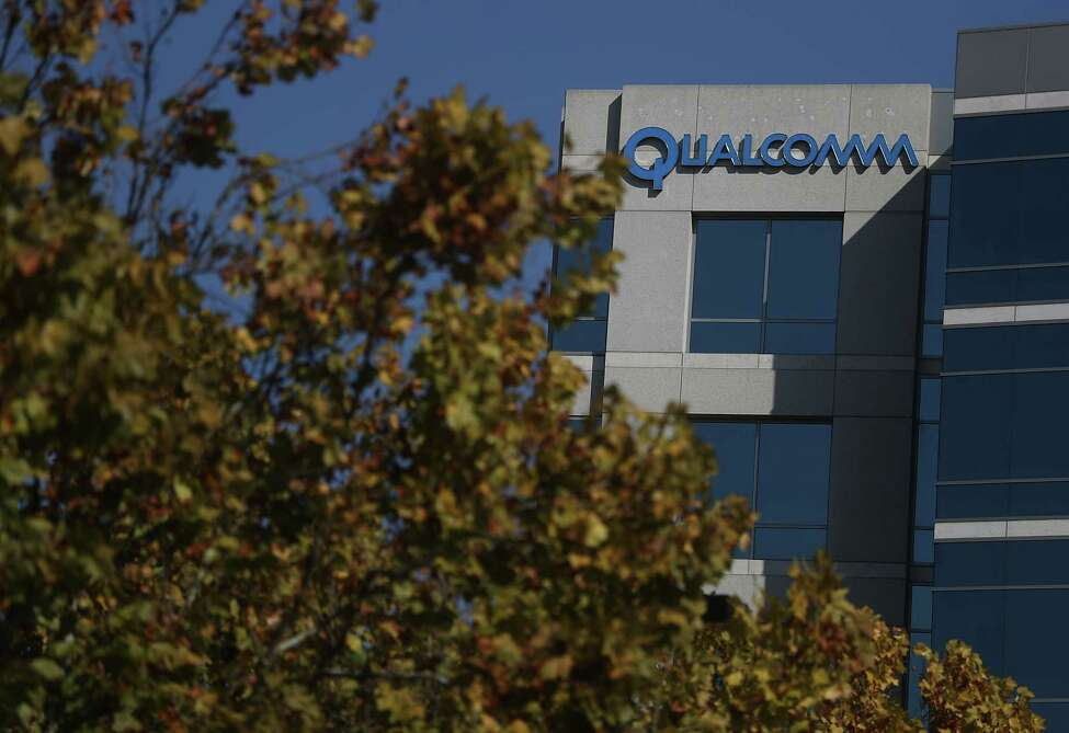 SAN JOSE, CA - NOVEMBER 01: A sign is posted at a Qualcomm office on November 1, 2017 in San Jose, California. As Apple and Qualcomm remain locked in a lengthy legal battle over patents and royalties held by Qualcomm, Apple is beginning to design prototypes of iPhones and iPads that will use Intel modems instead of Qualcomm modems. (Photo by Justin Sullivan/Getty Images) ORG XMIT: 775069160