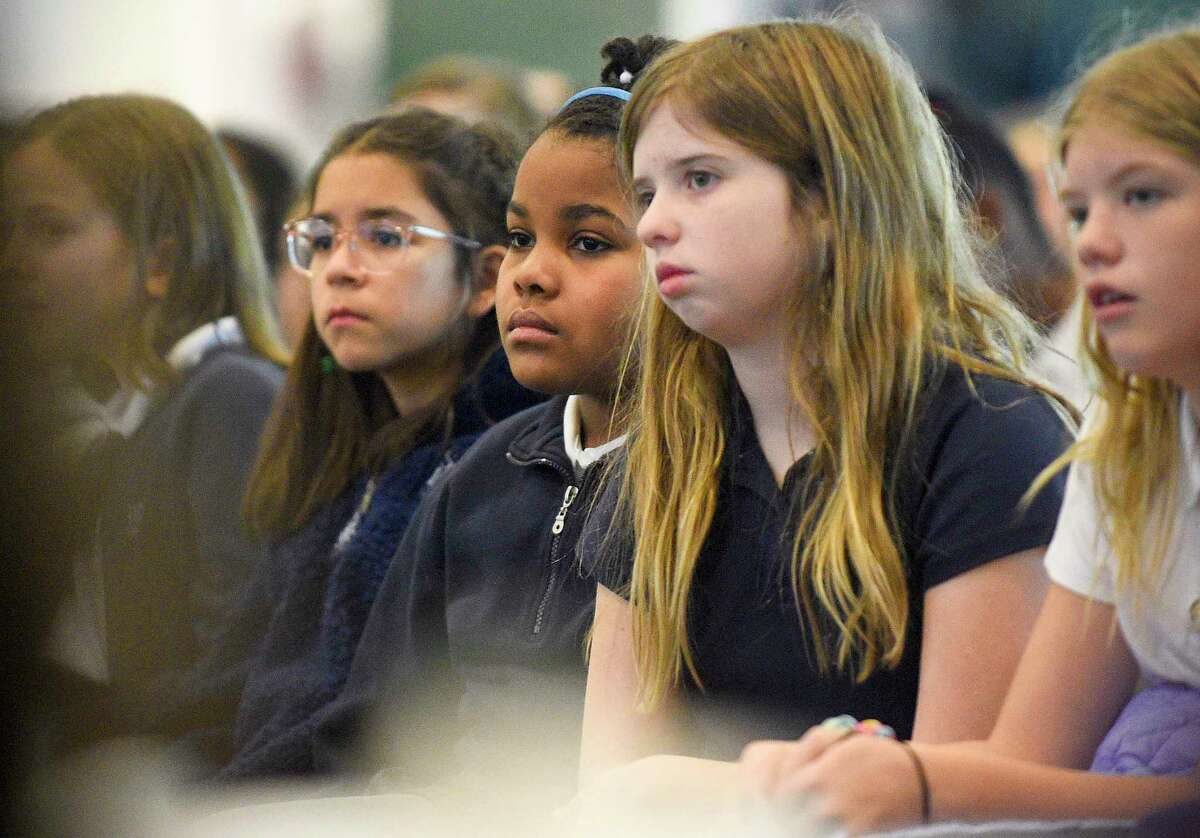 Students of Sacret Heart Greenwich school listen as Angela Lewis offers reflection during an all-school prayer service to remember Reverend Dr. Martin Luther King on Jan. 17, 2020 in Greenwich, Connecticut.