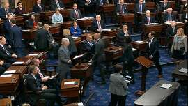 In this image from video, House impeachment managers depart the Senate chamber as the impeachment trial against President Donald Trump begins in the Senate at the U.S. Capitol in Washington, Thursday, Jan. 16, 2020. (Senate Television via AP)