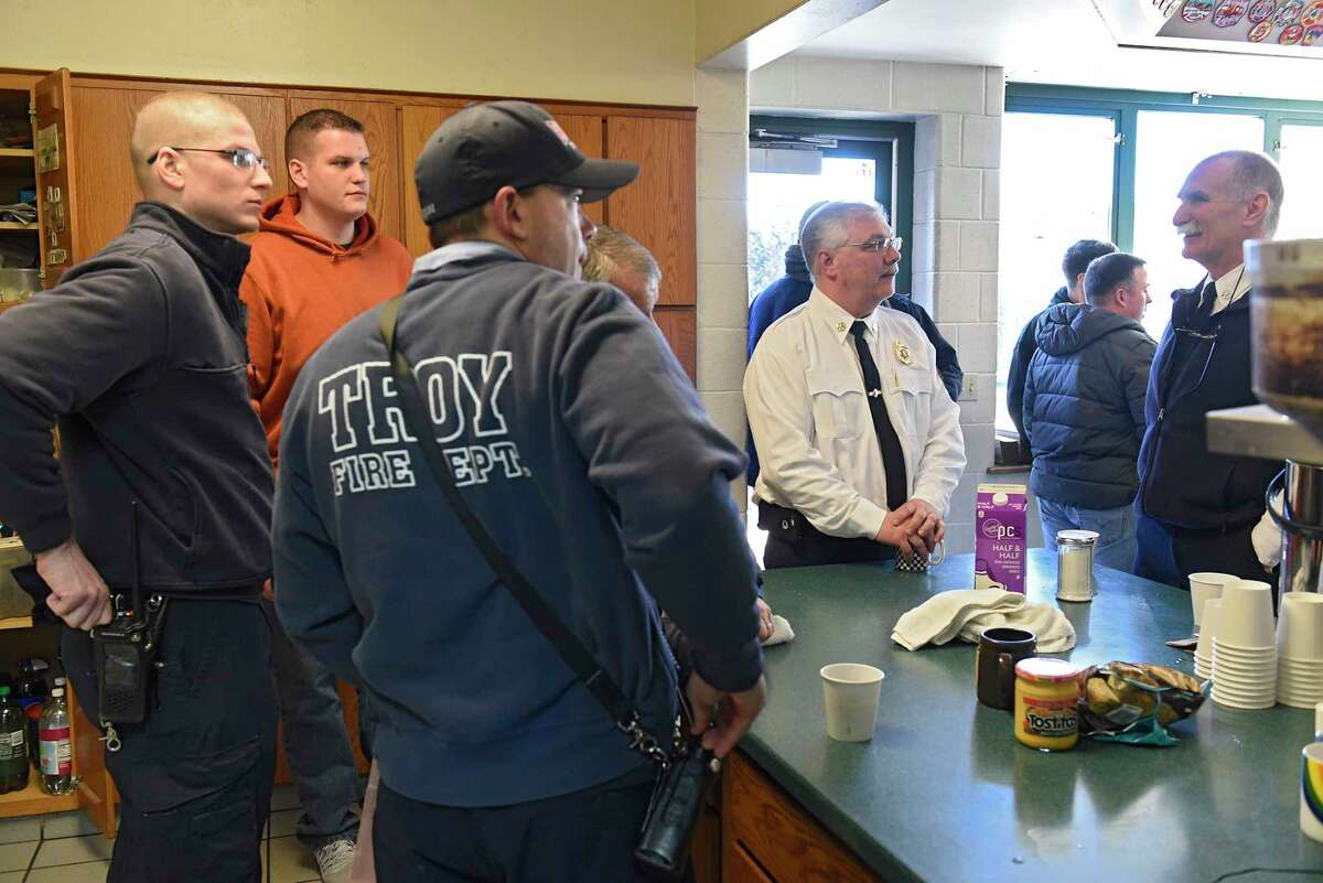 Deputy Fire Chief Tom Scorsone, second from right, is surrounded by co-workers and friends who came to wish him well in his retirement at the Troy Central Fire House on Friday, Jan. 17, 2020 in Troy, N.Y. (Lori Van Buren/Times Union)