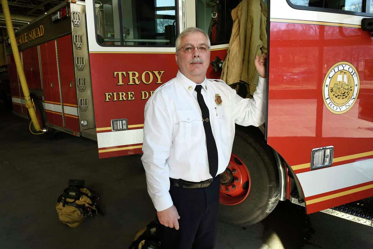 Deputy Fire Chief Tom Scorsone is seen next to a fire engine on the day of his retirement at the Troy Central Fire House on Friday, Jan. 17, 2020 in Troy, N.Y. (Lori Van Buren/Times Union)