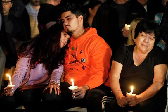 Cecilia Diaz, left, hugs her son, Dylan Cortes, as they attend a vigil for her son and his brother, Cesar Cortes, at Evelyn's Park in Bellaire Wednesday, Jan. 15, 2020. Cesar Cortes, 19, a Bellaire High School senior, died after being shot at the school yesterday. Cortes was killed in what officials described as an unintentional shooting on campus by a fellow JROTC classmate.