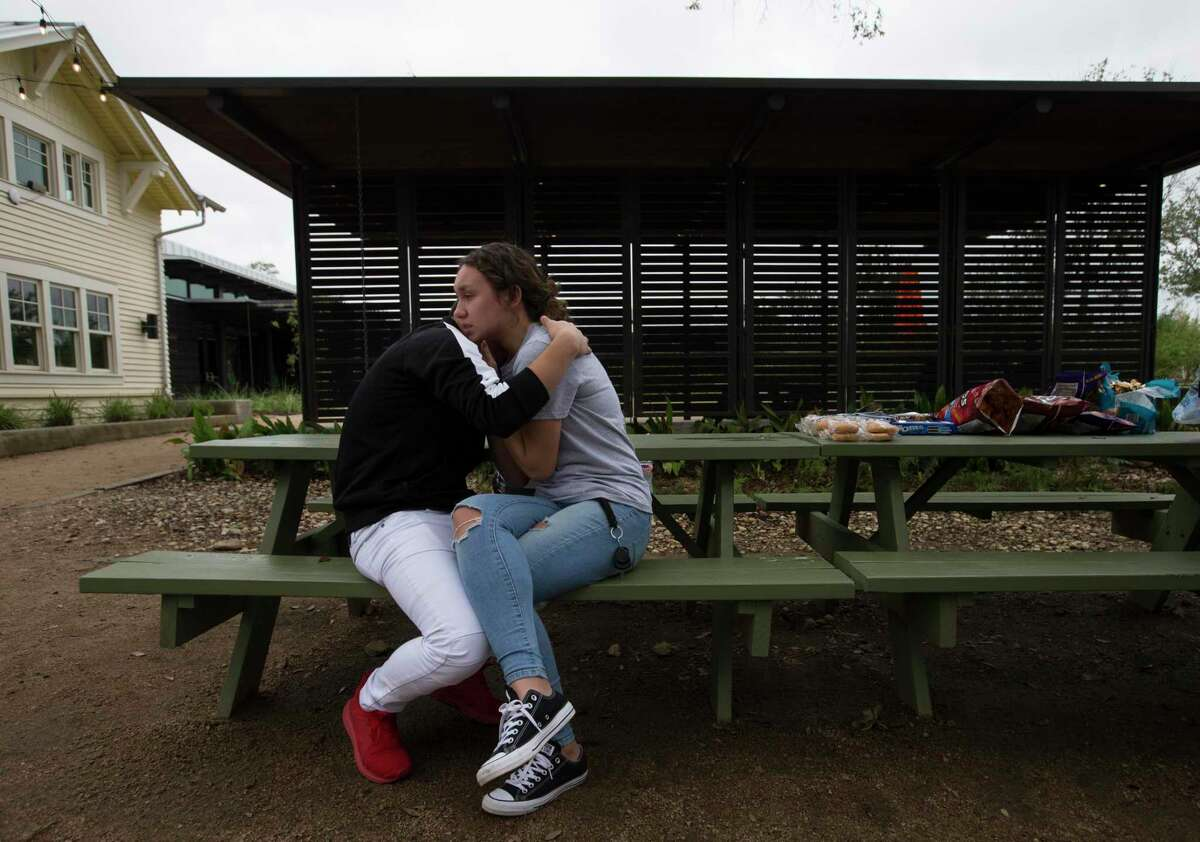 Bellaire High School students Emin Cruz, 16, and Grace Bandercan, 18, console each other at the gathering to remember the student who was shot and killed yesterday on campus at Evelyn Park on Wednesday, Jan. 15, 2020, in Bellaire. The victim was in the JROTC, and was shot by another student in the corps.