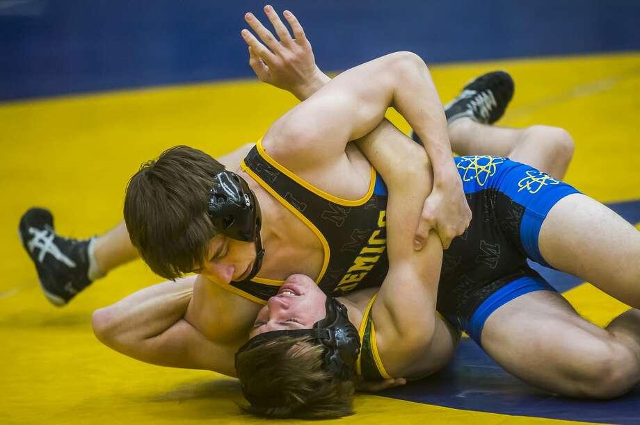 Dow's Robbie Batha, bottom, wrestles Midland's Alex Noey, top, during their meet Friday, Jan. 17, 2020 at Midland High School. (Katy Kildee/kkildee@mdn.net) Photo: (Katy Kildee/kkildee@mdn.net)