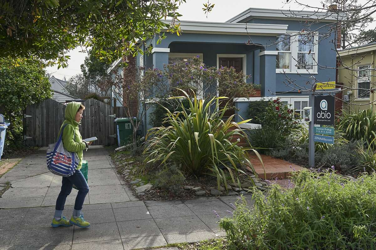 A pedestrian walks by real estate agent Shannon Prokup�s 2 bedroom, 1 bath house she has listed on Friday, Jan. 17, 2020, in Berkeley, Calif.