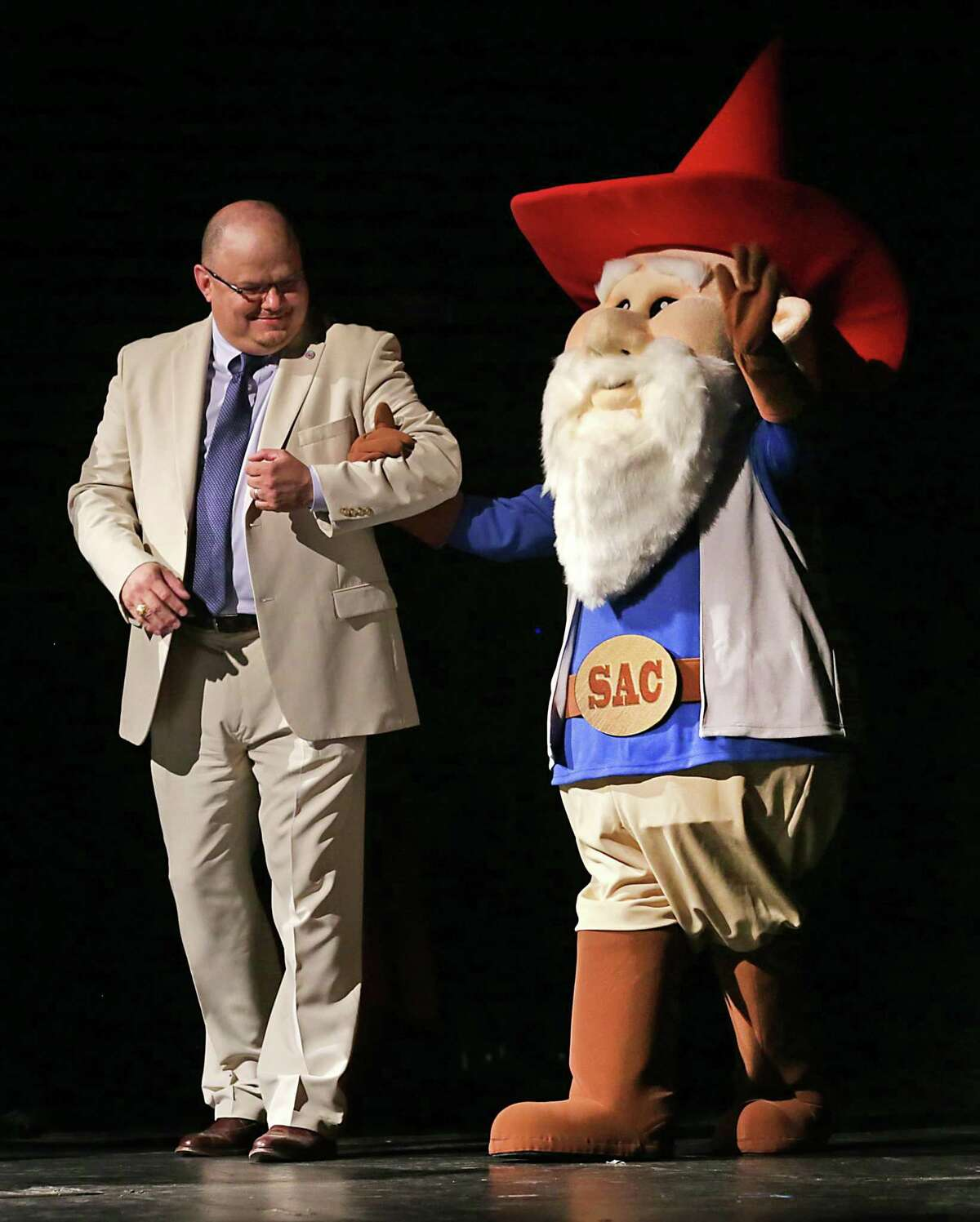 With his masked buddy, San Antonio College's Gnome Ranger ponders his exit.