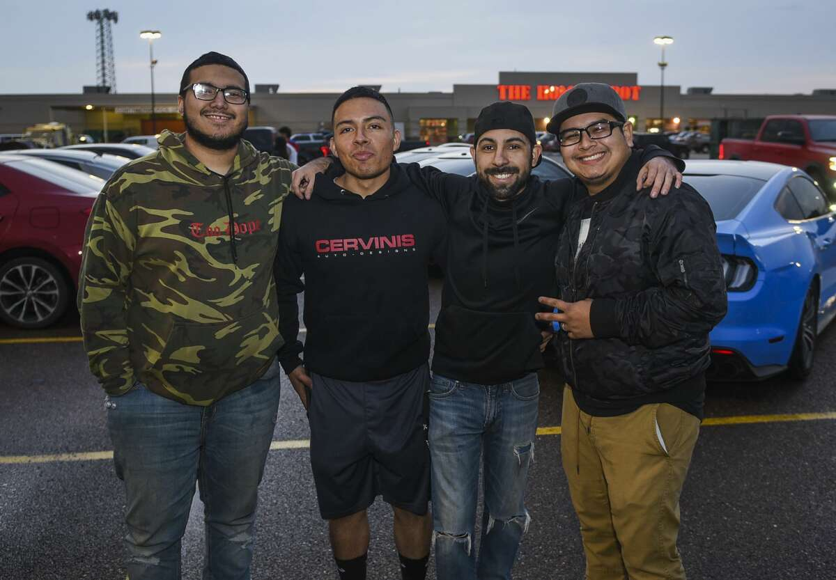 Custom car enthusiasts show up to the Hooters parking lot for the inaugural Hooters Car Show, Friday, Jan. 17, 2020.