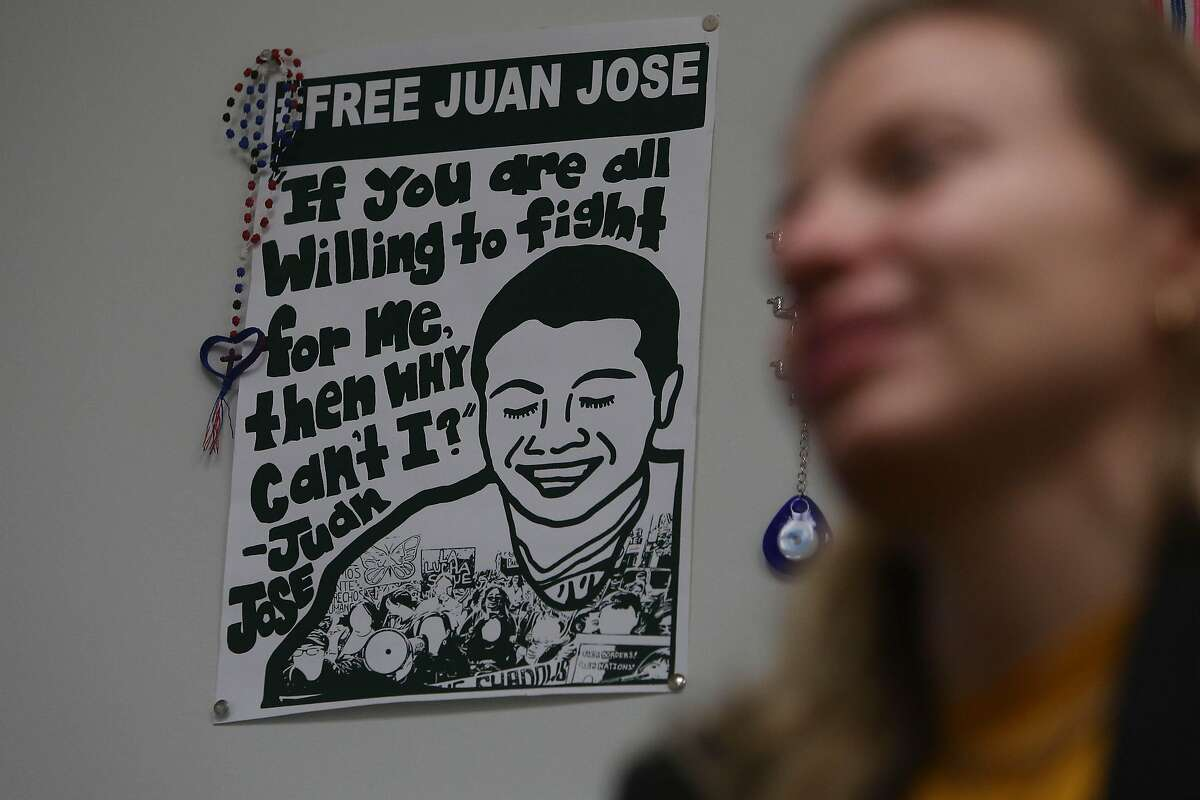 A poster for Juan Jose, who is a client of Kelly Engel Wells (right), deputy public defender, made by California Immigrant Youth Justice Alliance is seen on the wall in Wells' office in the Office of the Public Defender on Friday, January 17, 2020 in San Francisco, Calif. Jose is a 19 year-old asylum-seeker who has been in ICE custody at Yuba County Jail for nearly two years while his case is pending.