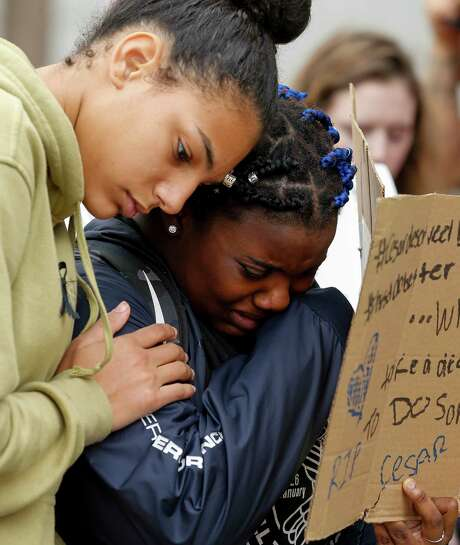 Laila Geers, left, consoles Jasmin McGee while a fellow Bellaire High School student spoke about 19-year-old Cesar Cortes, who was shot and killed Tuesday inside one of the school's classrooms. The students held a silent sit-in outside the Houston Independent School District Headquarters on Friday, Jan. 17, 2020.
