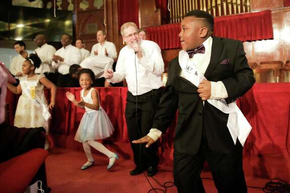 """Finalist Sean Gair dances as the Salvation Army Harbor Light Choir sings """"Celebration"""" while the judges tally the scores during the 2020 Martin Luther King, Jr., Oratory Competition on Friday, Jan. 17, 2020 at Antioch Missionary Baptist Church in Houston."""