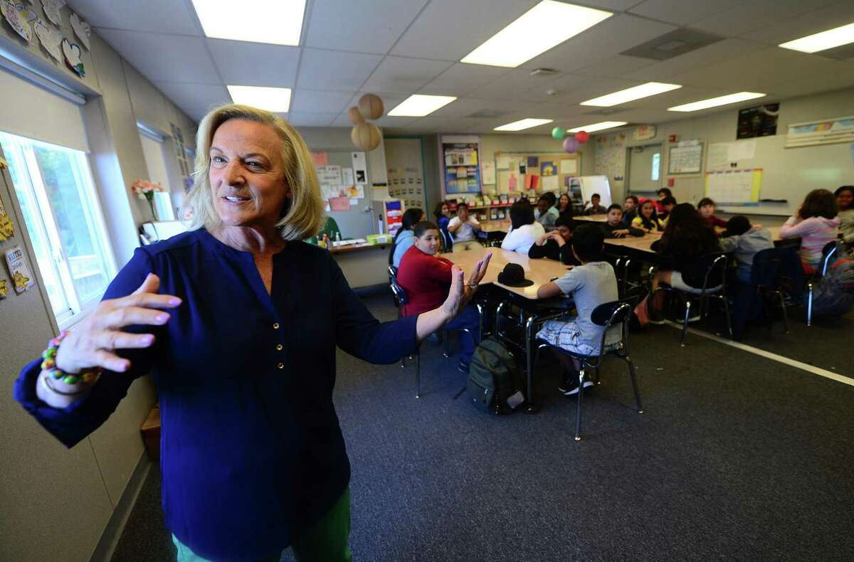 Jefferson Elementary School substitute teacher, Joanne Chariott, says students and teachers love the portable classrooms during an interview Wednesday, May 18, 2016, at the school in Norwalk, Conn.