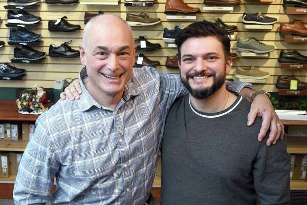 Matthew Arciuolo Jr., left, and his son, Matthew Arciuolo II, are photographed in their store, Arciuolo's Shoes, on South Broad Street in Milford.