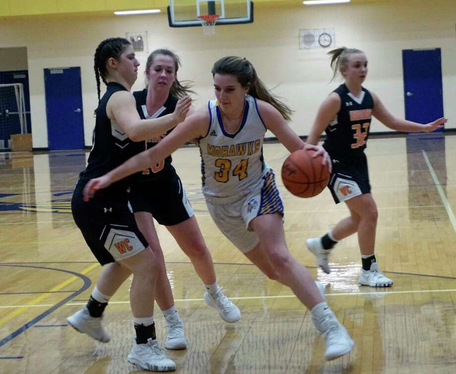 Brooke Brauher of Morley Stanwood prepares for heavy contact while driving for the basket during her team's 43-33 win over White Cloud at home on Friday night. (Pioneer photo/Joe Judd)