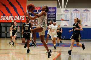 Grand Oaks point guard Jada Bennett (15) shoots a layup to finish off a fast break during the first quarter of a District 20-5A high school basketball game at Grand Oaks High School, Friday, Jan. 17, 2020, in Spring.