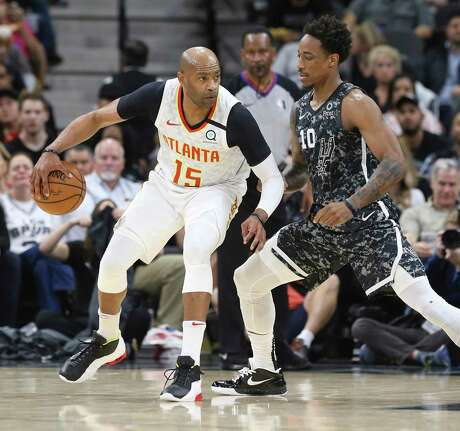 Spurs' DeMar DeRozan (10) defends against Atlanta Hawks' Vince Carter (15) during their game at the AT&T Center on Friday, Jan. 17, 2020.