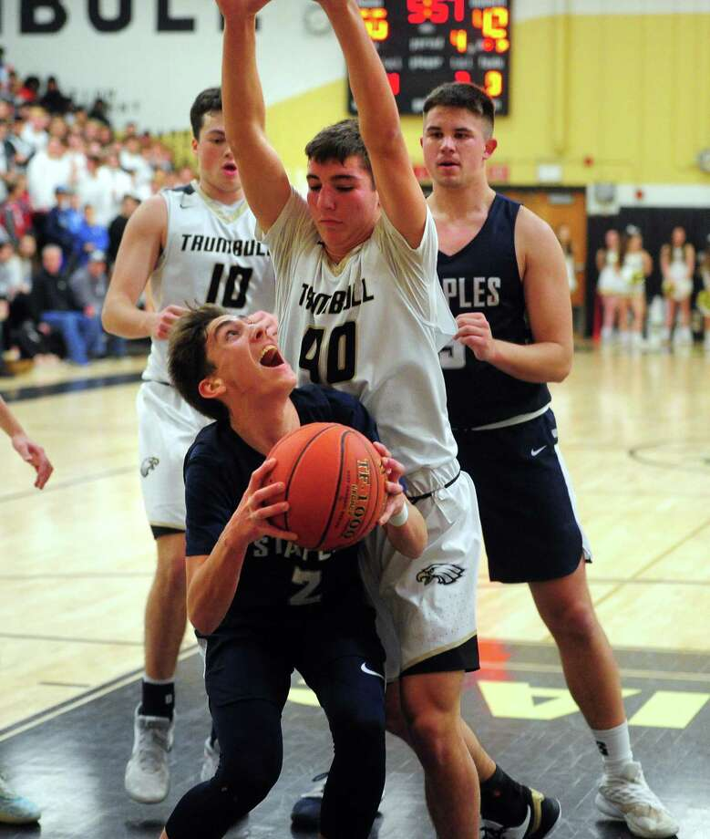 Staples' Benjamin Feuer (2) eyes the basket as Trumbull's Jake Gruttadauria (40) defends during boys basketball action in Trumbull, Conn., on Friday Jan. 17, 2020. Photo: Christian Abraham / Hearst Connecticut Media / Connecticut Post