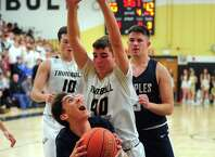 Staples' Benjamin Feuer (2) eyes the basket as Trumbull's Jake Gruttadauria (40) defends during boys basketball action in Trumbull, Conn., on Friday Jan. 17, 2020.