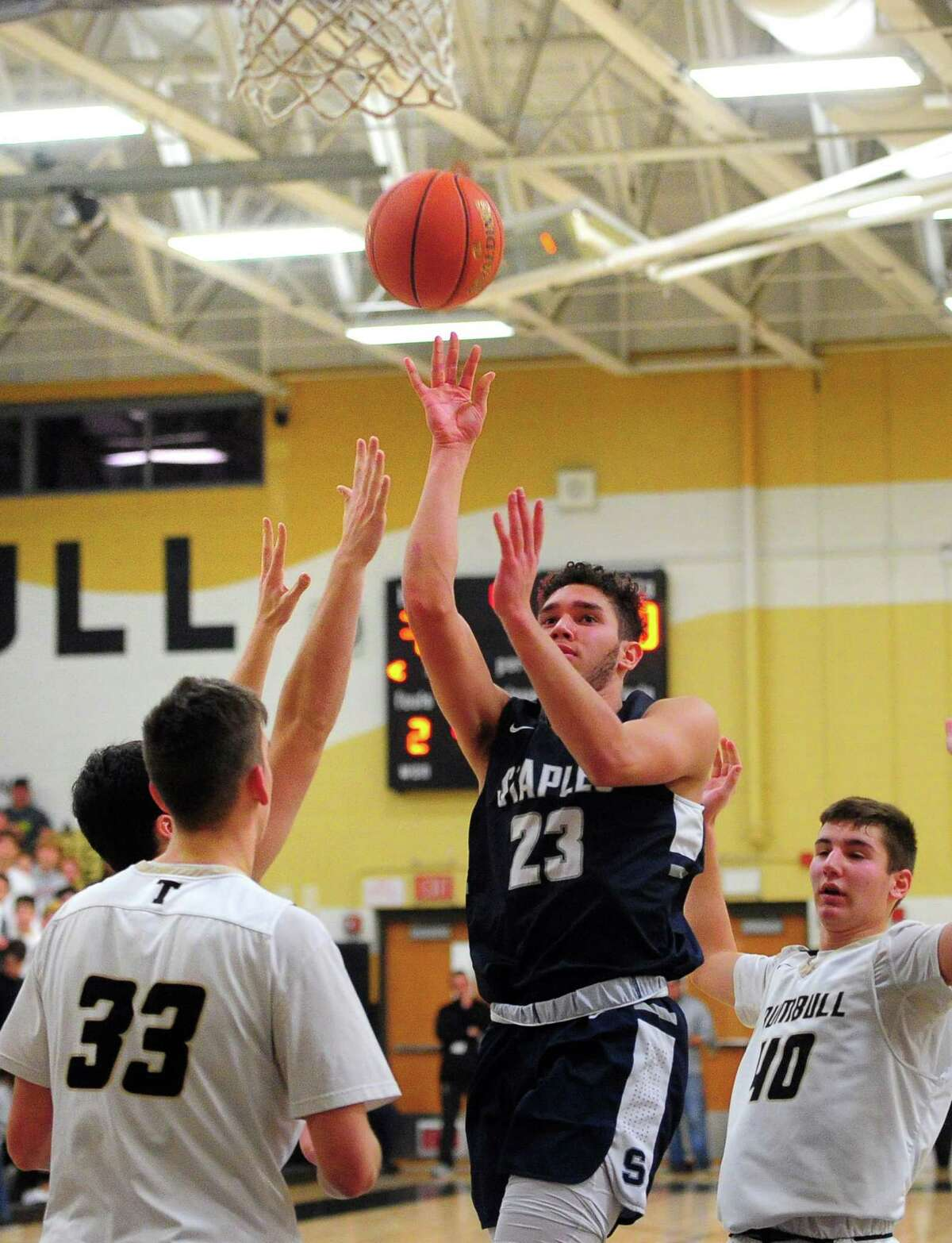 Staples' Lucas Basich (23) attempts a shot during boys basketball action against Trumbull in Trumbull, Conn., on Friday Jan. 17, 2020.