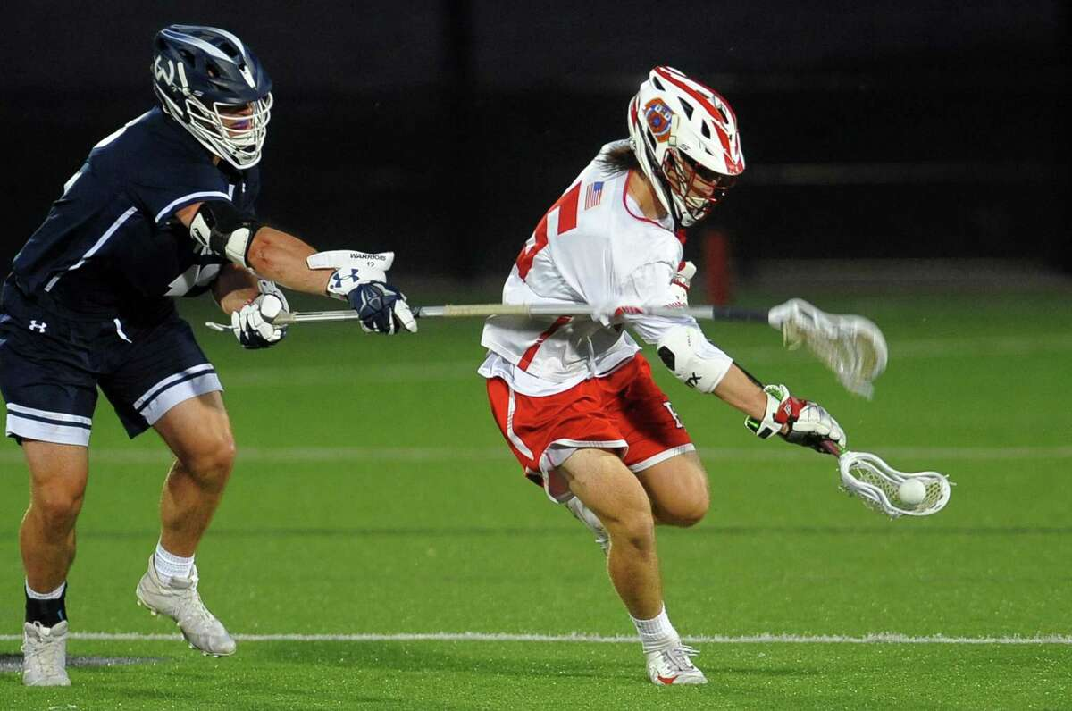 Fairfield Prep's Max McGillicuddy (6) scoops up the ball as Wilton's Ryan Schriber (12) tries to disrupt him during Class L boys lacrosse semi-final action in Fairfield, Conn., on Wednesday June 5, 2019.