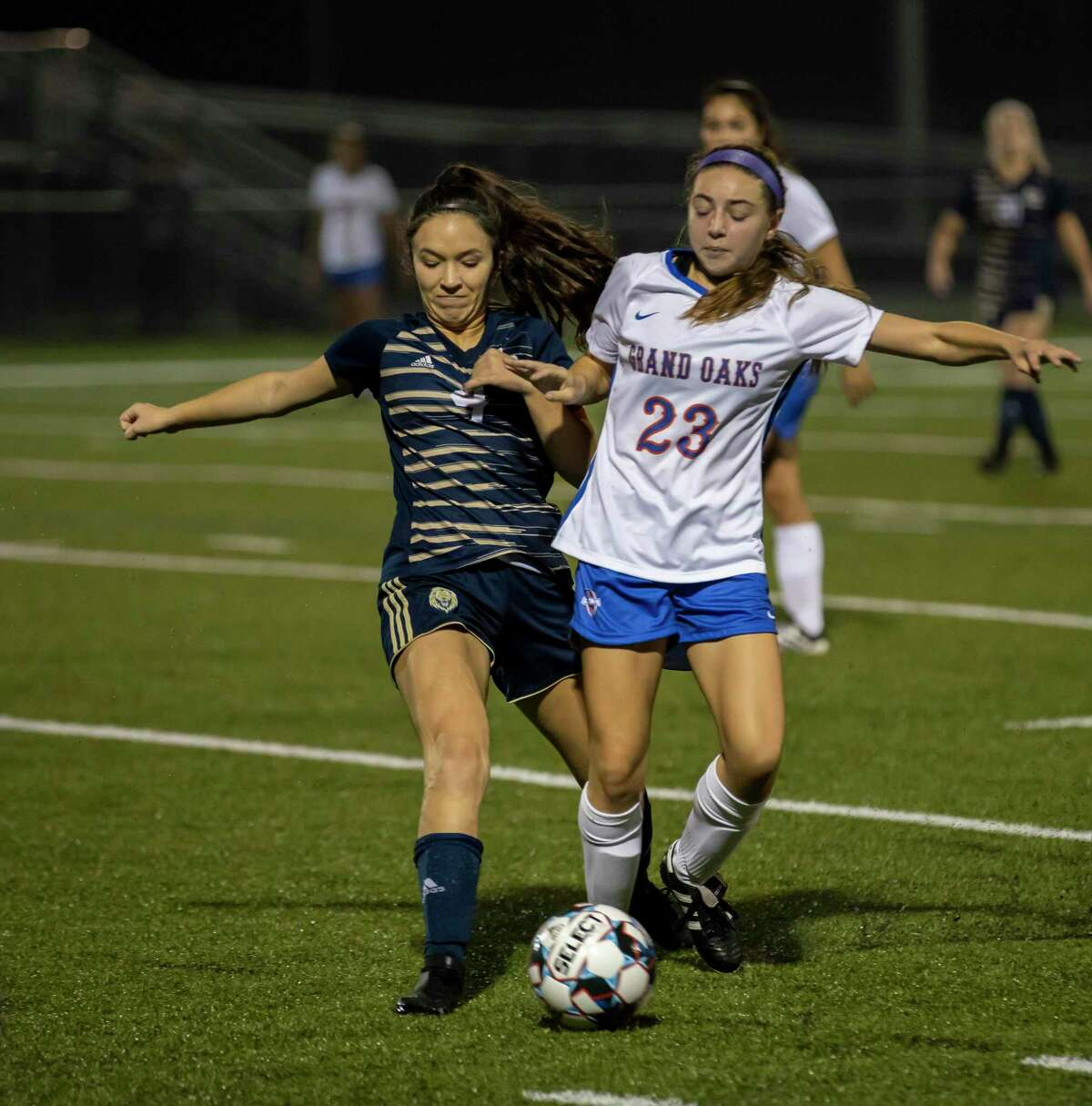 Lake Creek forward Kendal Kurth (4) and Grand Oaks defender Lauren Moylan (23) fight for control of the ball in a District 20-5A girls soccer game in Montgomery on Friday, January 17, 2020.