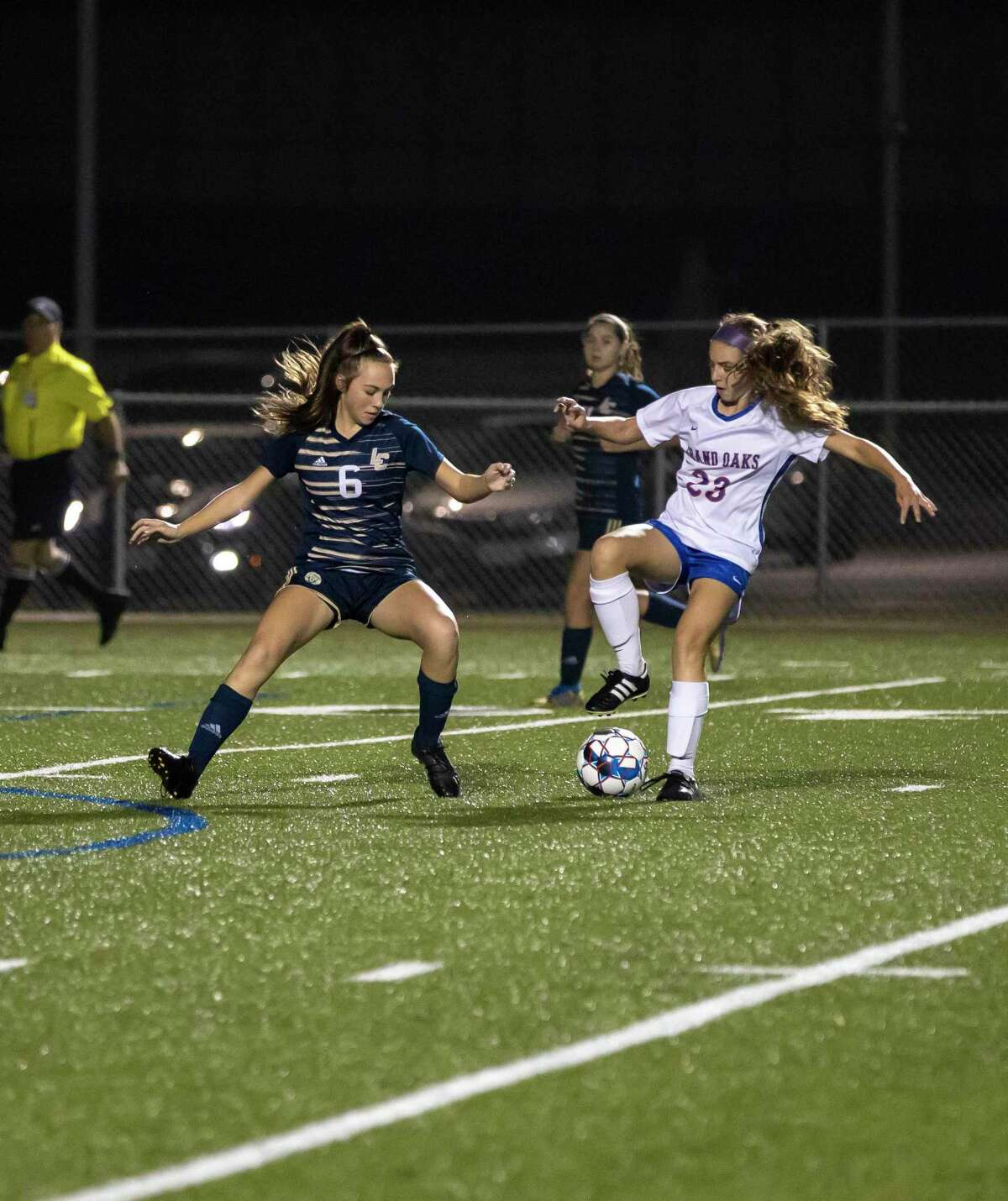 Lake Creek midfielder Morgan McGee (6) and Grand Oaks defender Lauren Moylan (23) fight for control of the ball in a District 20-5A girls soccer game in Montgomery on Friday, January 17, 2020.