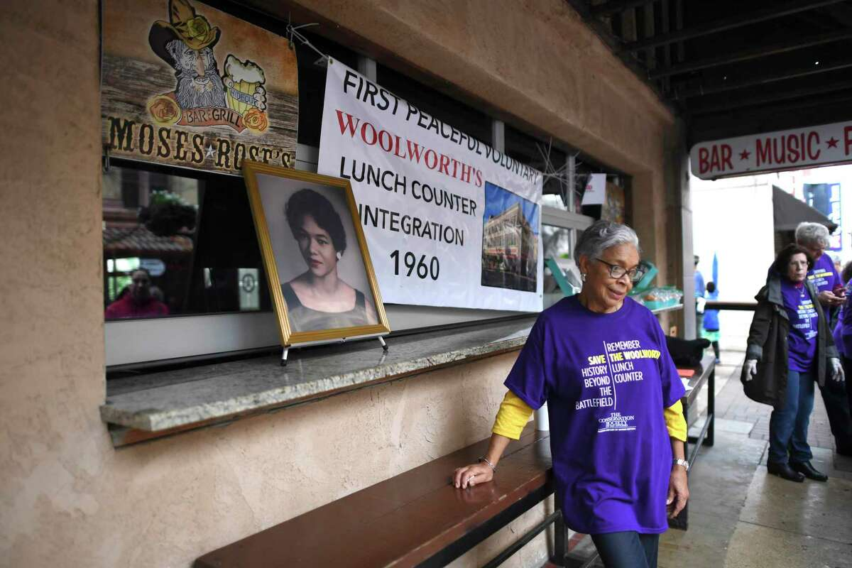 Thelma Andrews stands near a photo of relative Mary Lillian Andrews, once a president of the NAACP youth branch here.