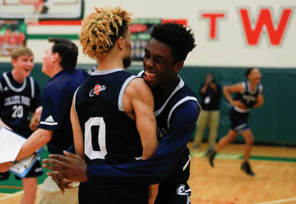College Park players reacts after defeating The Woodlands 48-46 during a District 15-6A high school basketball game at The Woodlands High School, Friday, Jan. 17, 2020, in The Woodlands.