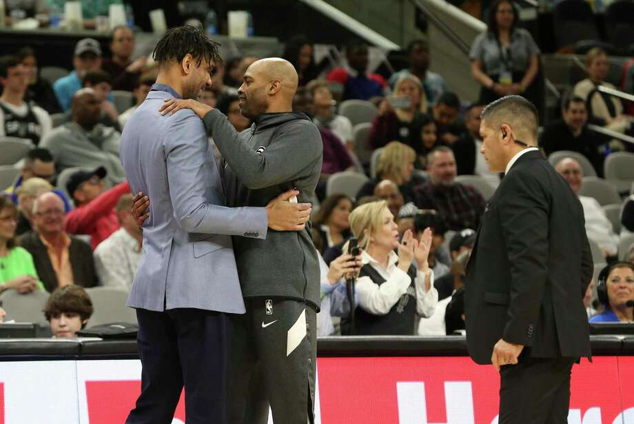 Spurs' assistant coach Tim Duncan (left) gets a hug from against Atlanta Hawks' Vince Carter (15) before the game at the AT&T Center on Friday, Jan. 17, 2020. Photo: Kin Man Hui, San Antonio Express-News / Staff Photographer / **MANDATORY CREDIT FOR PHOTOGRAPHER AND SAN ANTONIO EXPRESS-NEWS/NO SALES/MAGS OUT/ TV OUT