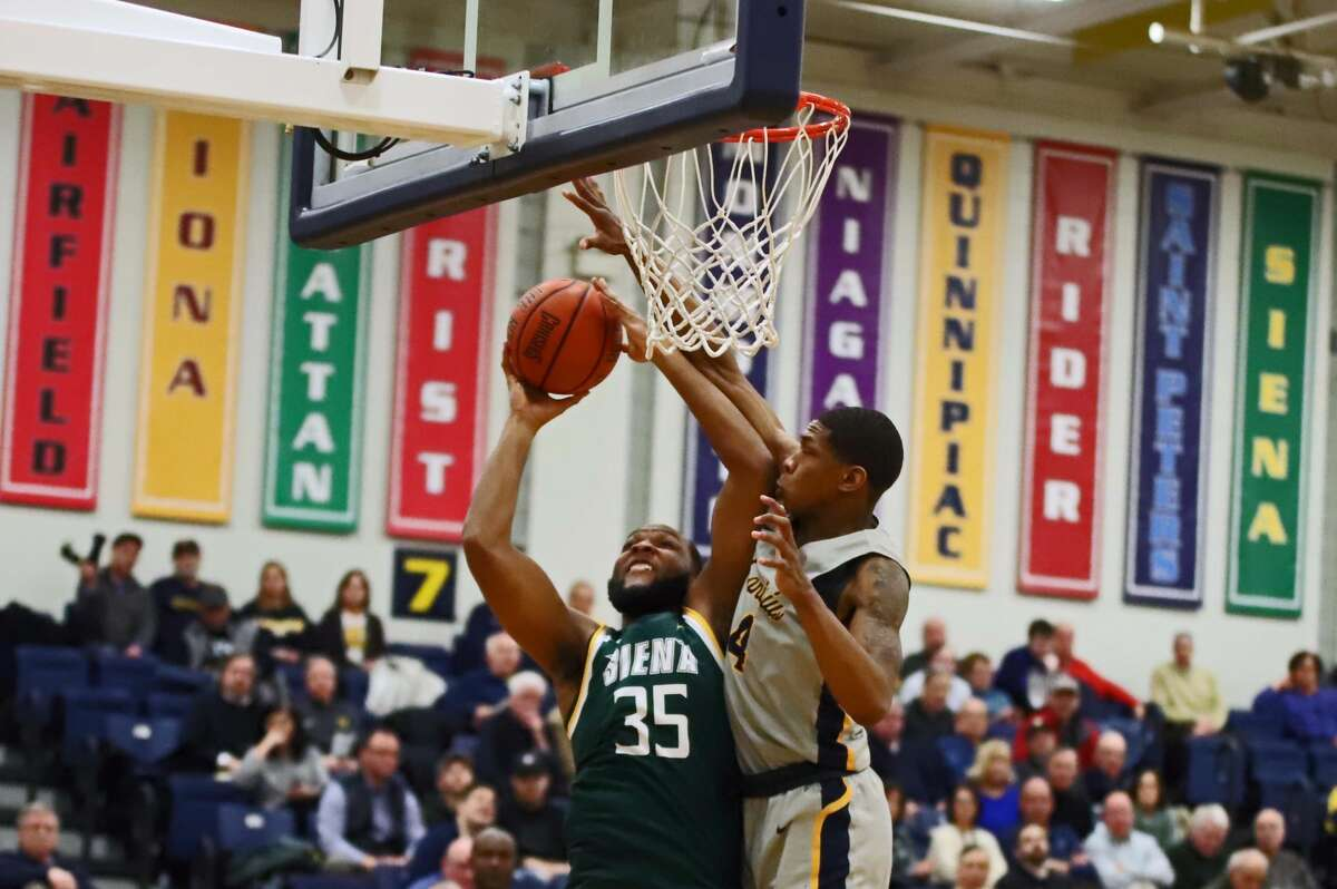 Sammy Friday drives to the basket against Canisius in their game at Koessler Center on Friday, Jan. 17, 2020. (Paul Battson / Special to the Times Union)