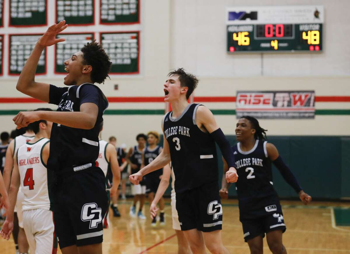 College Park guard Ty Buckmon (11) reacts beside guards Drew Calderon (3) and Marvin Dock (2) after defeating The Woodlands 48-46 during a District 15-6A high school basketball game at The Woodlands High School, Friday, Jan. 17, 2020, in The Woodlands.
