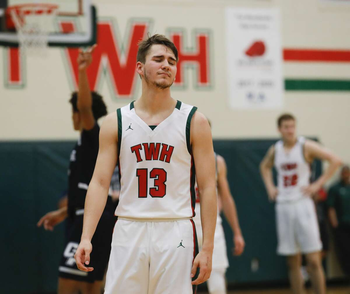 The Woodlands guard Tyler Hveem (13) reacts after a turnover in the closing seconds of the team's 48-46 loss to College Park during a District 15-6A high school basketball game at The Woodlands High School, Friday, Jan. 17, 2020, in The Woodlands.