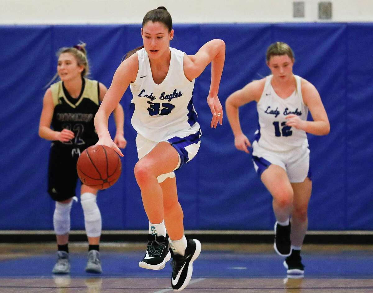 New Caney power forward Tori Garza (32) starts a fast break during the first quarter of a District 20-5A high school basketball game at New Caney High School, Tuesday, Dec. 10, 2019, in New Caney.