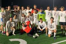 Lake Creek's boys soccer team poses for a team photo after their 2-1 win over Grand Oaks on Friday, Jan. 17, 2020. It was the program's first-ever district victory.