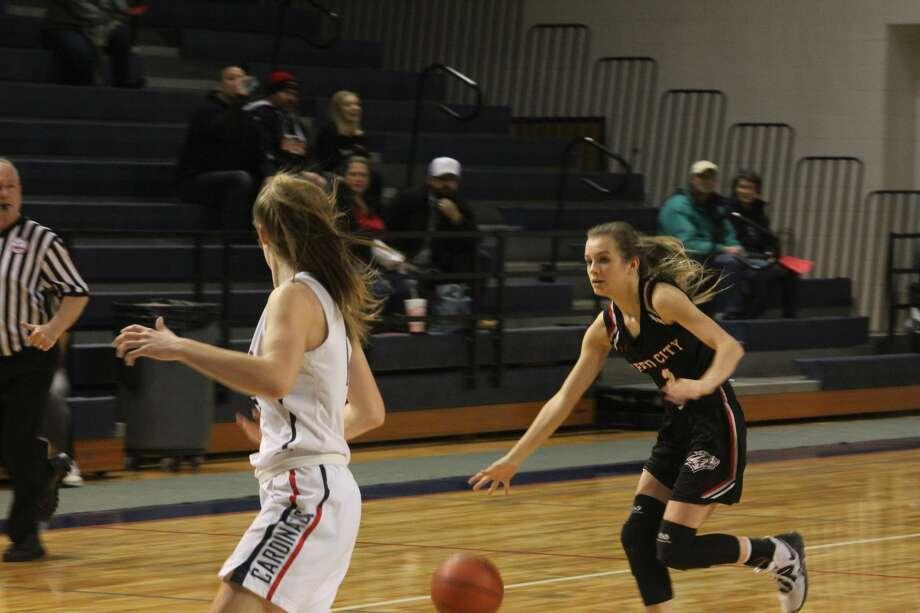 Big Rapids girls basketball team held back Reed City on Friday 45-38 in CSAA action. Photo: John Raffel
