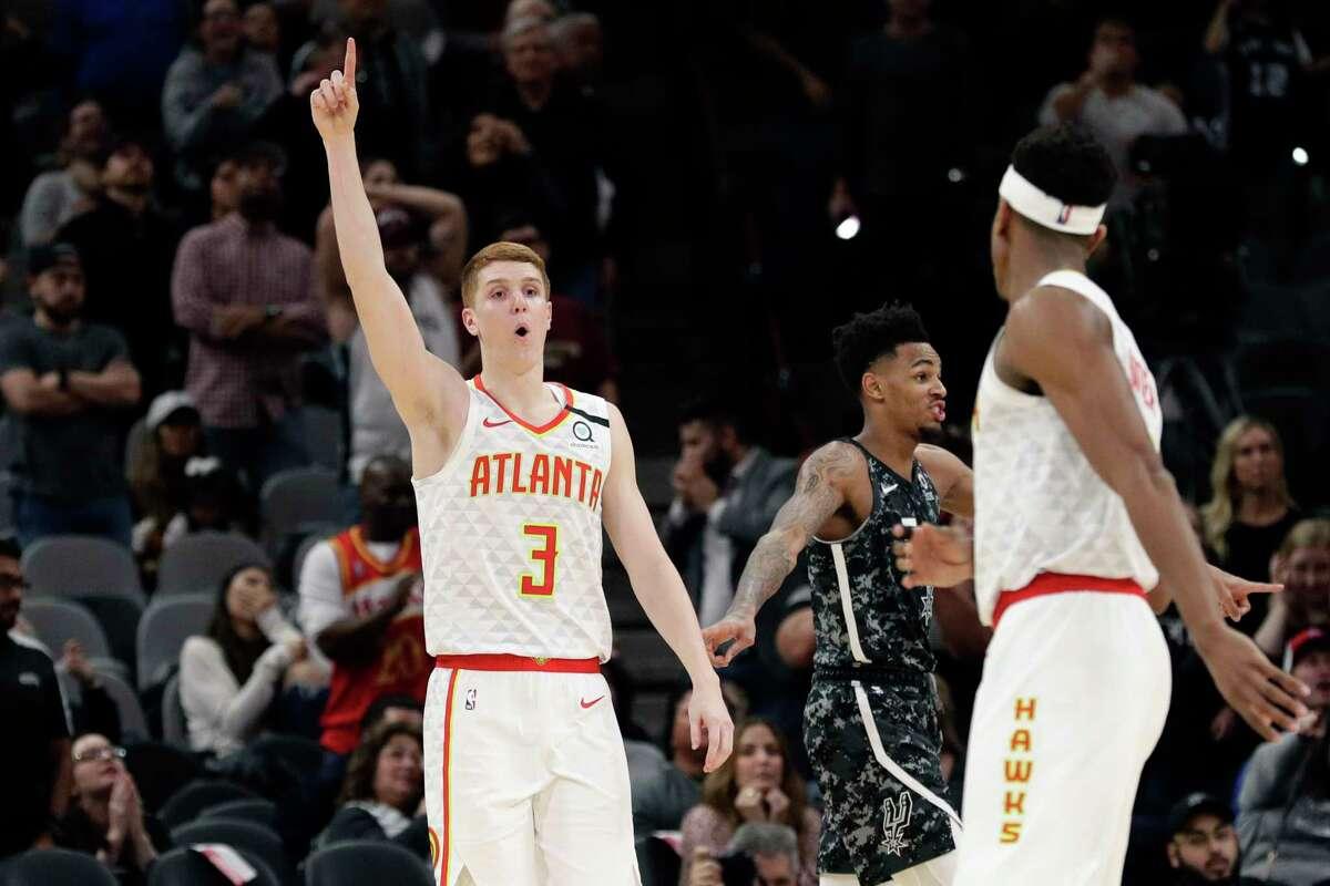 Atlanta Hawks guard Kevin Huerter (3) celebrates his winning shot against the San Antonio Spurs during the second half of an NBA basketball game in San Antonio, Friday, Jan. 17, 2020. (AP Photo/Eric Gay)